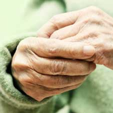 Elder woman's hands suffering from arthritis.